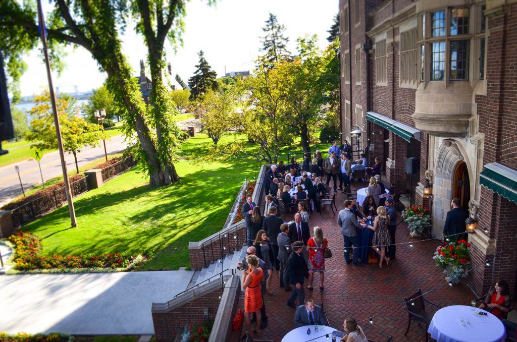 Kitchi Gammi Club patrons enjoying a sunny day on the outdoor patio