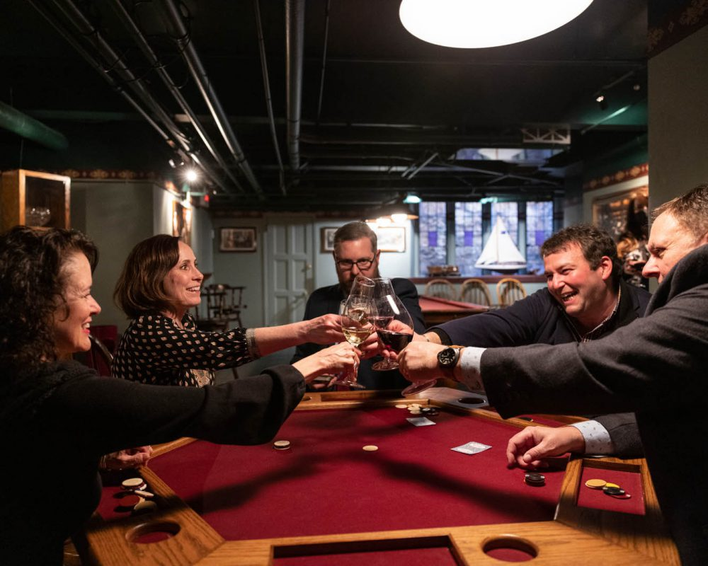 group of people toasting while gambling