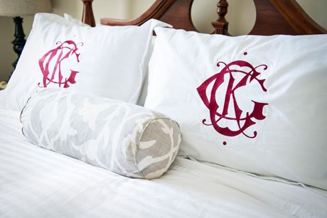 bedroom with monogrammed pillows
